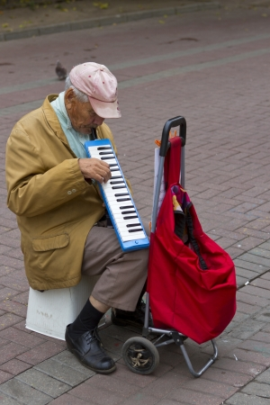 A solo melodian musician on Tverskoy Blvd, shopping steet in Moscow, Russia