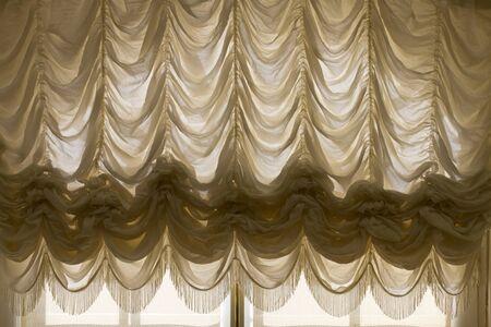 fold back: Drape White curtain on window