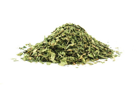 dried herbs: Dried peppermint pile isolated on white background Stock Photo
