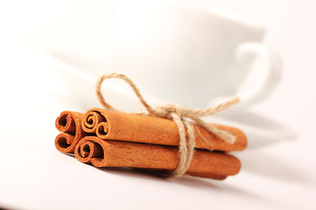 cinnamon stick: Cinnamon, cup with white background series Stock Photo