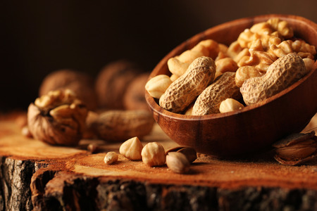 mixed nuts: Nut mix on wooden