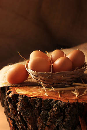 mistic: Eggs on wooden.