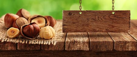 Nuts on wooden table 写真素材