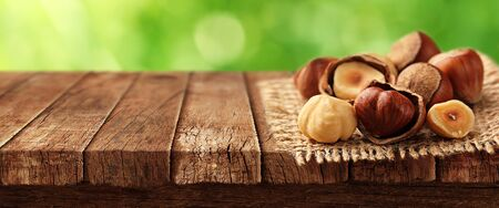 Nuts on wooden table 写真素材 - 131903483