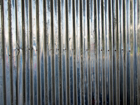 metal wall: Curly scratched zinc texture background Stock Photo