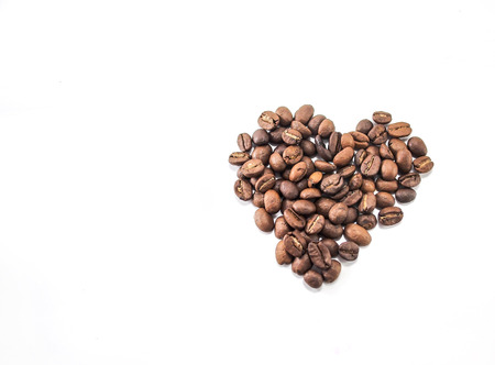 Isolated roasted arabica coffee beans Stock Photo