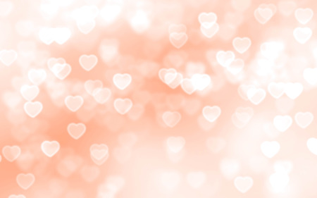 Bright peach color heart-shaped bokeh background Stock Photo
