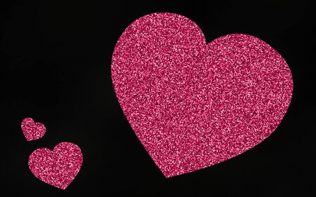 pink and black: Pink giltter heart on black background Stock Photo