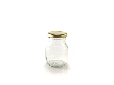 lid: Isolated transparent glass jar with golden lid