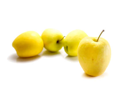 newzealand: Isolated yellow Newzealand apples on white background