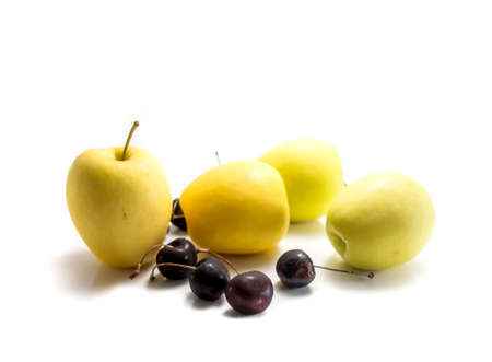 newzealand: Isolated yellow Newzealand apples with cherries on white background