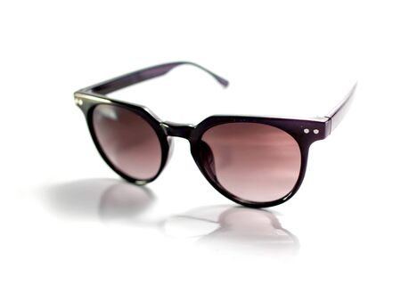 Isolated black sunglasses with purple lens on white background
