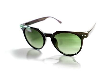 eyewear fashion: Isolated black sunglasses with purple lens on white background