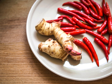 Galangal and chilli on the plate Thai food spices