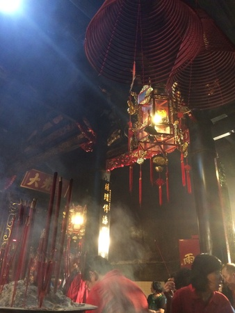 Photo of Incensed burned on the ceiling of temple altar