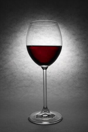 merlot: Beautiful glass of red wine on grey