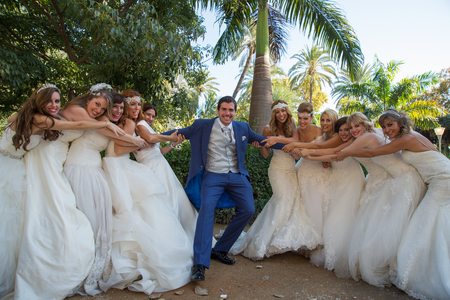 photography session: Group of Brides holding a groom Stock Photo