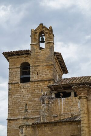 castile: Storks in the a church steeple of the Church of Saint Peter in Fromista, Castile and Leon, Spain