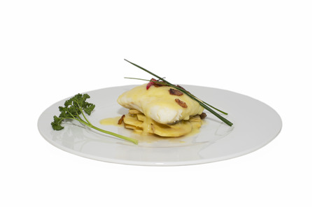 hake: Hake fillets with cheese sauce on a bed of potatoes