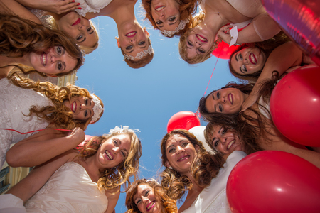 photography session: Group of brides looking down Stock Photo