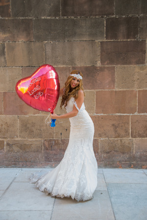 photography session: Blonde woman dressed as a bride