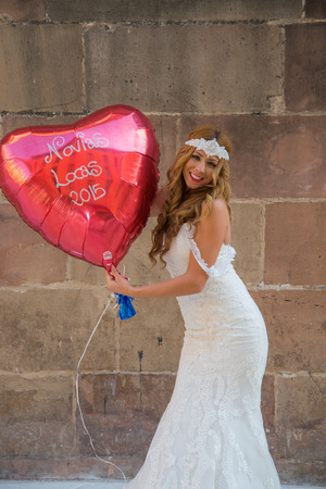 photography session: Bride with a big balloon Stock Photo