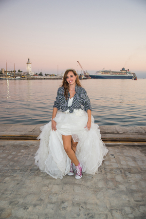 photography session: Bride with plaid shirt showing her sneakers