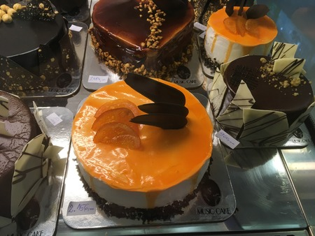 Delicious cakes from chocolate, orange and brown colors