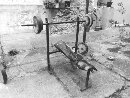 Vintage exercise machine, black and white photo Фото со стока