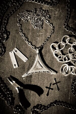 Metal silver rock jewelry photo with bulls head, animal skull, black and white.