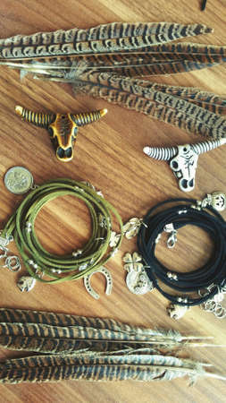 Fashion handmade jewelry photo olive green color with feathers and bull skull. Foto de archivo