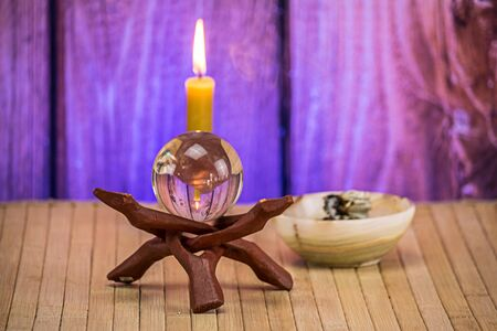 Crystal ball with incense and candle