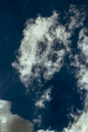 Abstract cloud structures on blue sky
