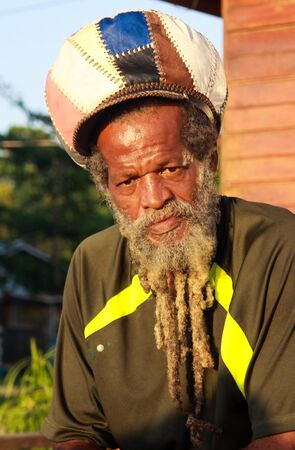 NEGRIL, JAMAICA - MAY 24. 2010: Portrait of rasta man with beard, dredlocks and rastacap Editorial