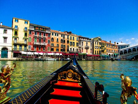 VENICE, ITALY - SEPTEMBER 19. 2018: Gondola boat trip on venetian grand and small chanels