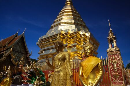 Golden roofs and towers of pagoda contrasting with dark blue cloudless sky - Wat Phra That Doi Suthep pagoda in Chiang Mai, Thailand