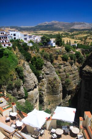 View on ancient village Ronda located precariously close to the edge of a cliff in Andalusia, Spain