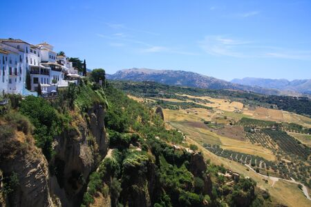 View on ancient village Ronda located on plateau surrounded by rural plains in Andalusia, Spain