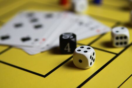 Close up of dices and cards on yellow game board