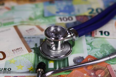 Medical cost concept - Stethoscope on euro paper money bank notes