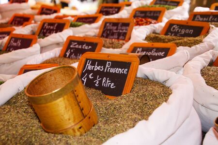 Choice of French spices (herbes de Provence) in white bags. Name of spice is written on small chalkboards. St. Tropez, France