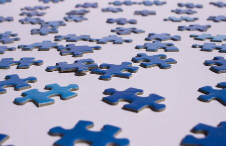 Close up of isolated blue puzzle pieces, white background