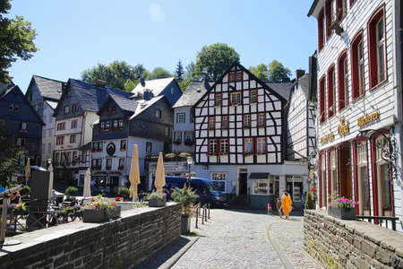 Monschau, Germany (Eifel) - July 9, 2020: View over bridge on square with timber frame monument houses in center of medieval village