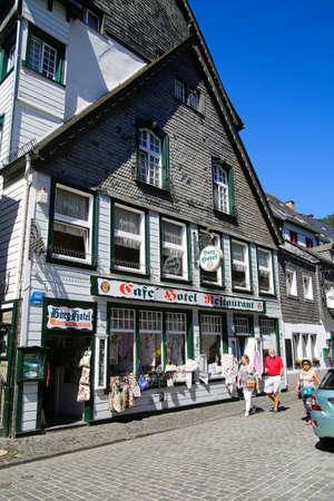 Monschau, Germany (Eifel) - July 9, 2020: View on street with timber frame monument house in center of medieval village Redactioneel