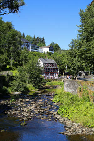 Monschau, Germany (Eifel) - July 9, 2020: View over river on timber frame monument house and restaurant