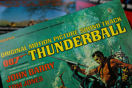 Viersen, Germany - July 9. 2020: Closeup of isolated vintage vinyl record cover with soundtrack of movie James Bond 007 thunderball from the seventies (focus on center of word thunderball) Editoriali