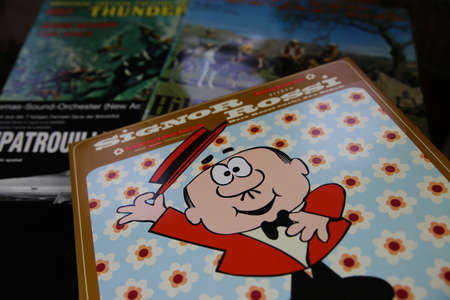 Viersen, Germany - July 9. 2020: Closeup of isolated vintage vinyl record cover with soundtrack of cartoon tv series from the sixties and seventies (focus on) Editoriali