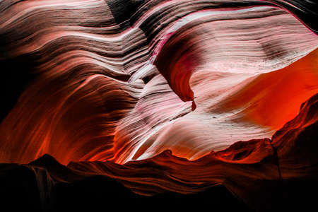 View into abstract red sandstone cave with wavy lines - antelope canyon, arizona