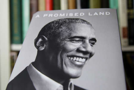 Viersen, Germany - January 2021: Close up of isolated book cover Barack Obama a promised land, shelf background Editorial