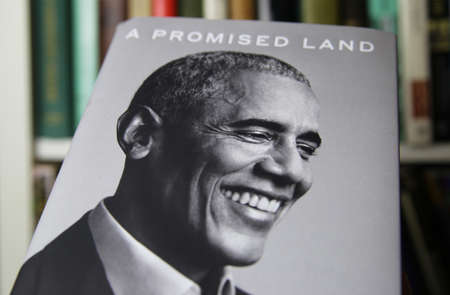 Viersen, Germany - January 2021: Close up of isolated book cover Barack Obama a promised land, shelf background